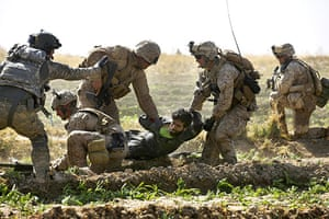 Operation Moshtarak: Marines with wounded Taliban fighter, Marjah, Helmand province, Afghanistan