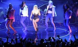 Lady Gaga performs with dancers