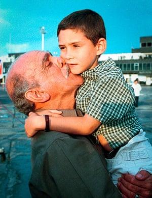 Elian Timeline: Elian Gonzalez is cradled by his grandfather after his arrival in Havana