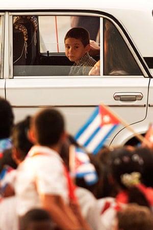Elian Timeline: Elian Gonzalez looks at his fellow school children on his arrival in Havana