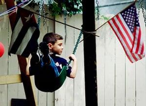 Elian Timeline: Cuban boy Elian Gonzalez swings between the Cuban and U.S. flags