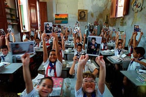 Elian Timeline: Young pupils at the school attended by Elian Gonzalez hold pictures of him