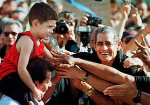 Elian Timeline: Elian Gonzalez sits on his uncle's shoulders as he is greeted in Miami