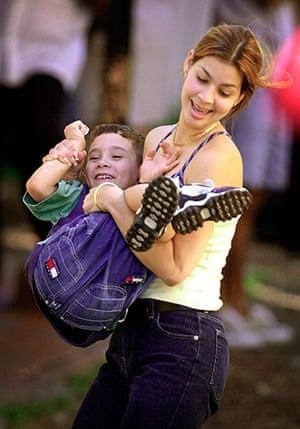 Elian Timeline: Elian Gonzalez plays with his cousin Marisleysis in Little Havana