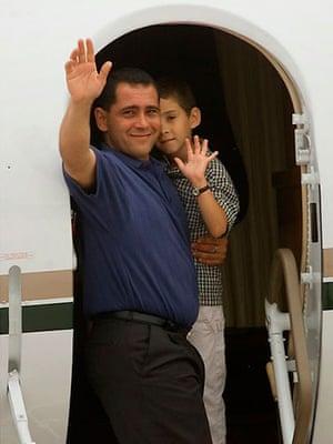 Elian Timeline: Elian Gonzalez and his father Juan Miguel Gonzalez wave goodbye
