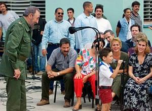 Elian Timeline: Fidel Castro looks at former castaway Elian Gonzalez