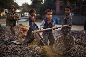 Eyewitness: Children in New Delhi work with their parents