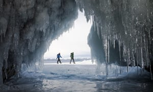 A couple of hikers on the frozen Lake Baikal in Siberia