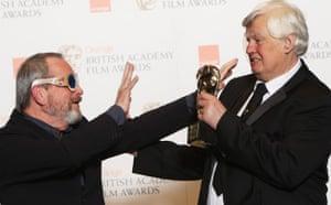 Baftas 2010: winners: Baftas 2010: Terry Gilliam poses with Joe Dunton