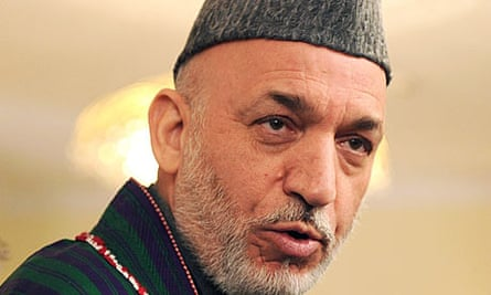 Hamid Karzai addresses a press conference