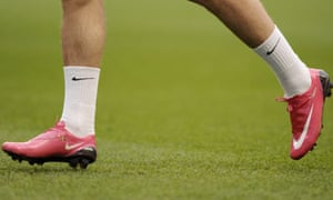 Nicklas Bendtner with his pink Nike football boots