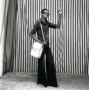 Malick Sidibé Gallery: Young Man With Bellbottoms, Bag And Watch, 1977