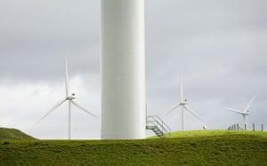 Wind Energy: Wind turbines operate at the Tararua Wind Farm on the hills