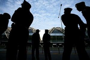 Thaksin Shinawatra: February 28 2008: Police officers stand guard outside Bangkok Airport
