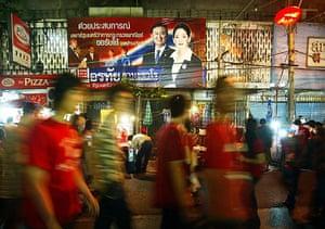 Thaksin Shinawatra: People walk past an election campaign bi