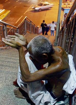 Thaksin Shinawatra: 17 November 2003: A beggar near a train station in Bangkok