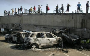 Chile Earthquake: People look at destroyed cars after Chile earthquake
