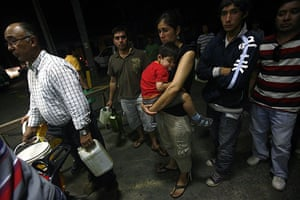 Chile Earthquake: Chileans line up for gasoline after a major earthquake in Pelluhue, Chile