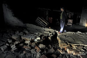 Chile Earthquake: A resident living in the streets following earthquake in Santiago, Chile