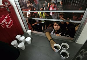 Chile Earthquake: Salvation Army hands out coffee on streets of Santiago Chile earthquake
