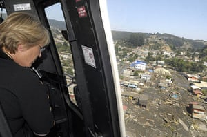 Chile Earthquake: Chile's President Michelle Bachelet looks at damaged houses in Concepcion