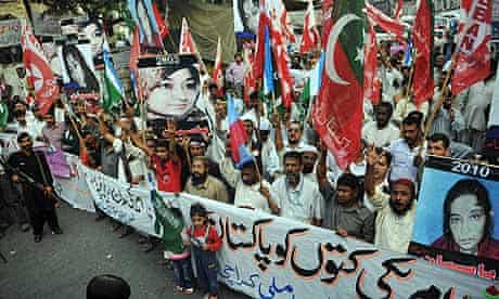 Pakistani activists protest against the conviction of Aafia Siddiqui during a rally in Karachi