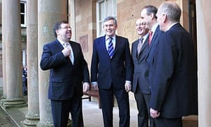 Brian Cowen, Gordon Brown and other MPs before Northern Ireland's power-sharing deal announcement