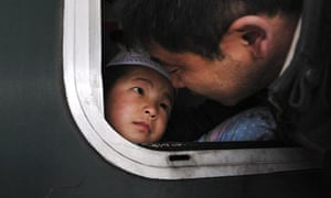 A father sees his seven-year-old son off at a railway station in Hefei, China