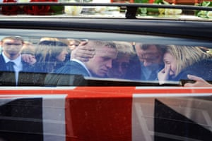 24 Hours in Pictures: Hearses carrying the coffins of two British soldiers drive past