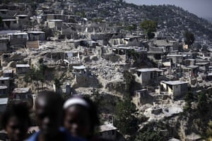 24 Hours in Pictures: Collapsed houses are seen at a hill in Port-au-Prince