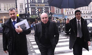 Boris Berezovsky, flanked by security men, walks into the high court