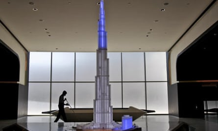 A man sweeps at the entrance to the Burj Khalifa's observation deck