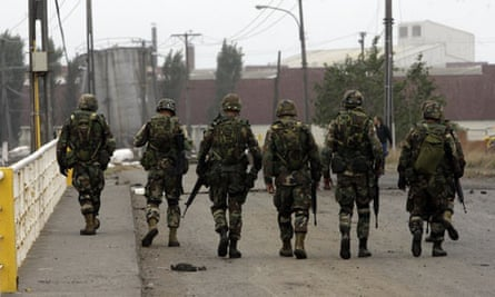 Soldiers guard the streets of Talcahuano, southern Chile, after an earthquake struck.