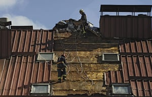Storm damage in Europe: Fireman work on a damaged roof after a storm in the Basque city of Vitoria