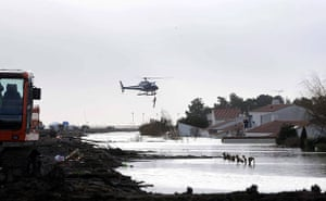 Storm damage in Europe: A helicopter evacuates inhabitants after flooding in L'Aguillon sur Mer