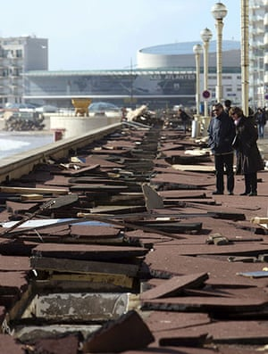 Storm damage in Europe: People look at the damage caused to the boardwalk at Les Sables d'Olonne