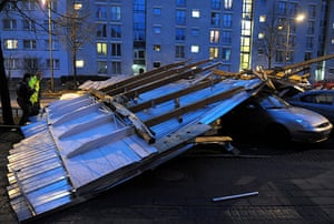 Storm damage in Europe: Police officers check damaged cars under a roof in Cologne, Germany