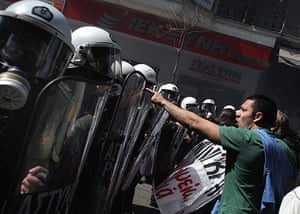more strikes in greece: A protester confronts riot police during a demonstration in central Athens