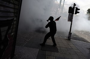 more strikes in greece: A demonstrator wearing a gas mask in Athens