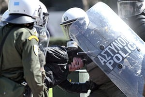 more strikes in greece: Riot police detain a demonstrator in Athens