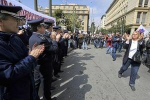 more strikes in greece: Striking policemen applaud passingdemonstrators in Athens
