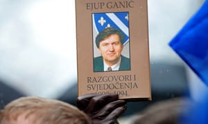 Ejup Ganic book held by protestor