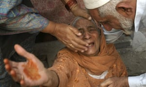 A Pakistani woman mourns a victim of the Lahore suicide bombing