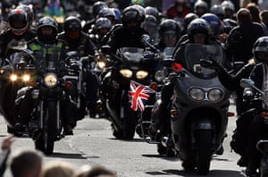 Wootton Bassett bikers: Some of the 10,000 bikers pass along the High Street