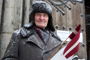 Legionnaires' Day Latvia: A Latvian Legion veteran walks to the Monument of Freedom