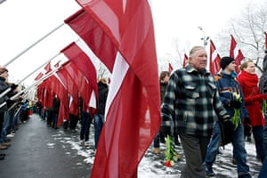 Legionnaires' Day Latvia: Veterans of the Latvian Legion walk to the Monument of Freedom