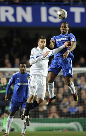 Chelsea v Inter: Didier Drogba rises high above Thiago Motta to easily win a header