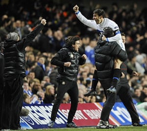 Chelsea v Inter: Javier Zanetti leaps into a coach's arms as he celebrates Inter's goal