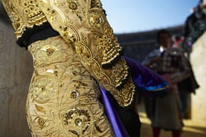 24 hours in pictures: A bullfighter stands on before a bullfight at the Plaza Valencia bullring