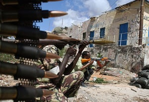 24 hours in pictures:  Somalian government soldiers hold a position March